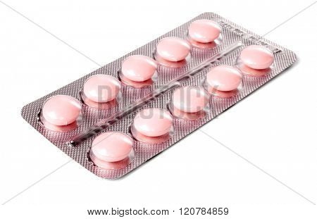 Pack of pink tablets isolated on white background.