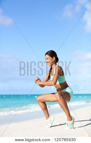 Fitness woman doing bodyweight workout training calves with plie squat calf raise exercise. Asian sport girl doing a ballet inspired ballerina pose to activate glutes and lower body by raising heels.