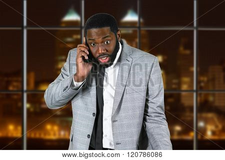 Troubled black businessman in office.