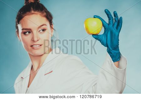 Scientist Doctor With Rotten Apple. Gm Food.