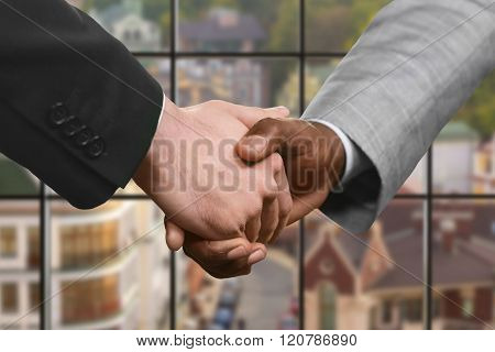 Business partners' handshake at daytime.