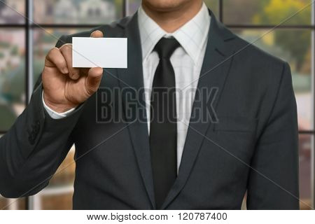 Office manager shows visit card.