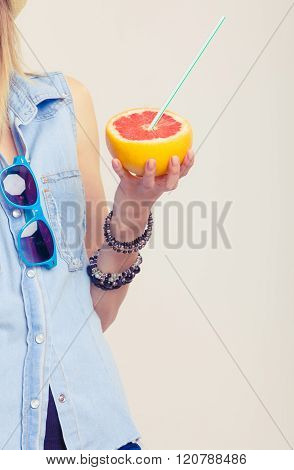 Summer Girl Holding Grapefruit Drink