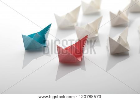 Leadership concept using blue paper ship