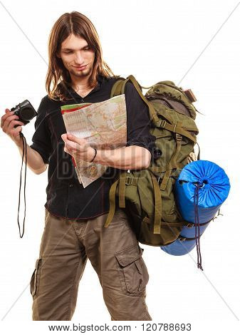 Man Tourist Backpacker With Camera Reading Map.