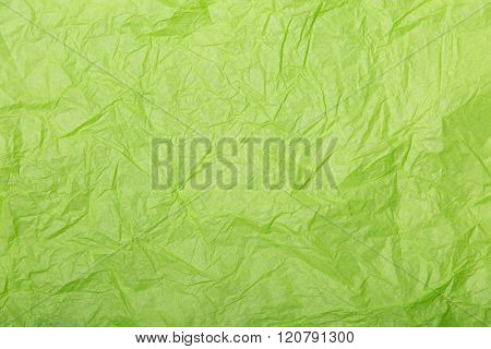 Close-up shot of lime green wrinkled paper texture