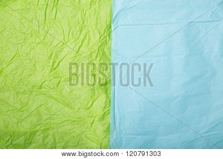 Close-up shot of lime green and baby blue wrinkled paper textures