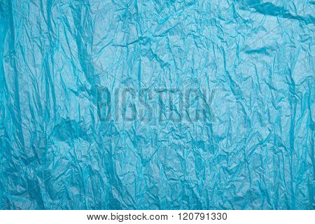 Wrinkled texture of blue wrapping paper