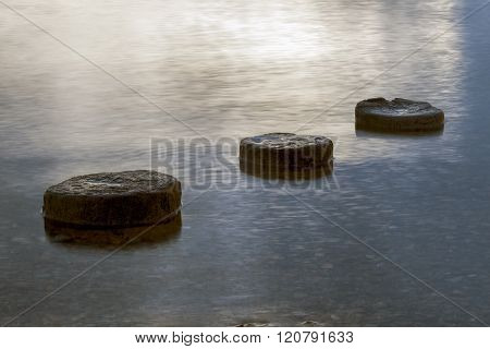 Three Objects In Lake Water.