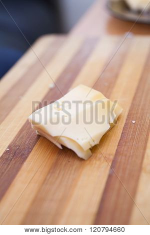Piece Of Cheese On A Table