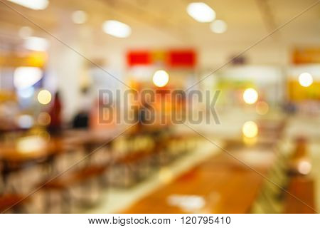 blur image of cafeteria in the University and sun light