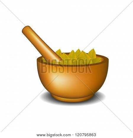 Wooden mortar with pestle and brown leaves