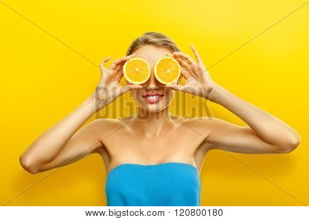 Young Woman With Fruits On Bright Orange Background