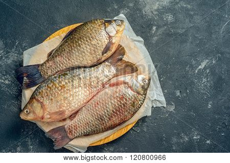Three Fresh Carp On Wooden Board, Top View, With Copy Space