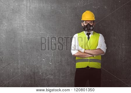 Asian Worker Wearing Safety Vest And Yellow Helmet