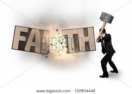 Man Using Hammer Cracking Faith Word Wooden Board.