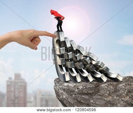 Man Carrying Arrow Up Balancing Falling Euro Symbols Hand Helping