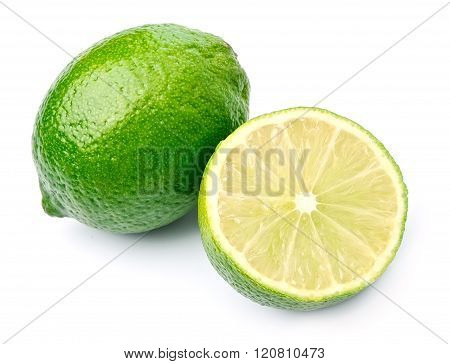 Citrus lime fruits with leaves close up isolated on white