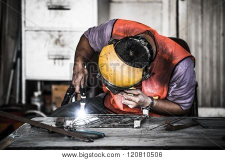 Hdr Image Of A Technician Using Tig Welder In Factory's Workshop
