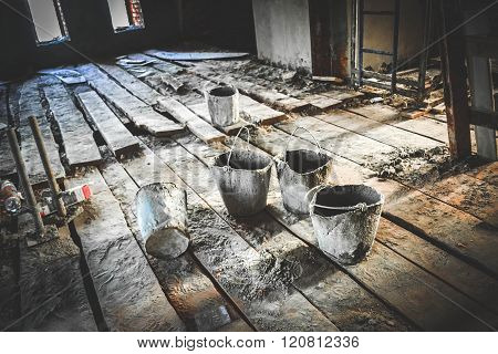 old dirty bucket at a construction site