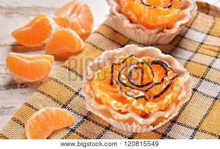Tasty and homemade cupcakes with fresh mandarins