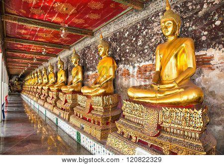 Bangkok, Thailand- Jan 20, 2016:Rows of Buddha Images around  Wat Suthat Thep Wararam Buddhist temple on Jan 7,2016 in Bangkok, Thailand.