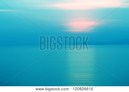 Abstract background motion blurred of refraction in water with sunset on the sea at twilight times - Blue Tone