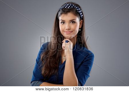 Portrait of confident young attractive woman.