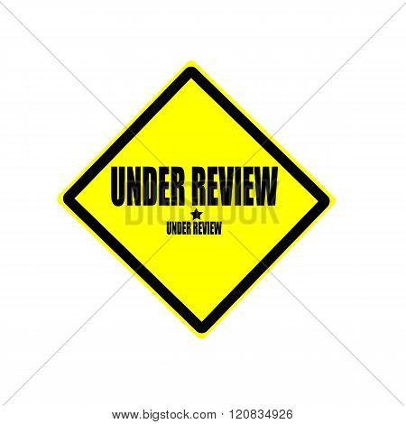 Under Review Black Stamp Text On Yellow Background