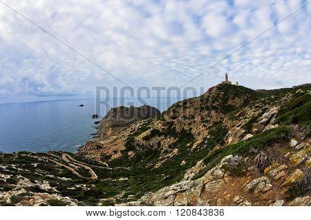 Lighthouse at Capo Sandalo on west coast of San Pietro island, Sardinia