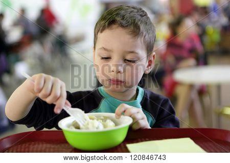 Kid Eating Meat Dumplings