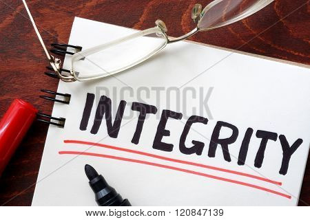 Integrity written in a notebook.