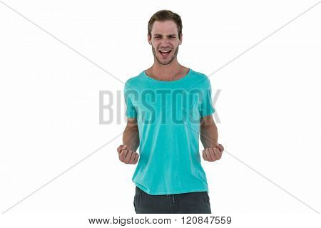Portrait of successful hipster with clenched fist on white background