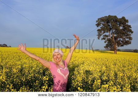 Happy Woman In Field Of Golden Canola