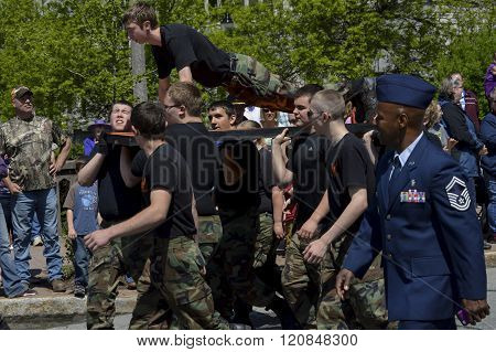 Bangor, Maine/USA-May 26: Young men representing an JRROTC group rotate push up duties to show strength and unity during the Memorial Day Parade on May 26, 2014 in Bangor, Maine.