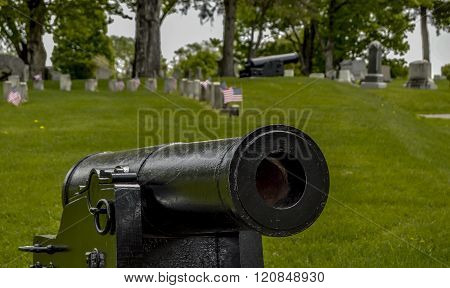 Bangor, Maine/USA-May 25: Freshly painted black cannons at the ready at the perimeter of the Mount Hope Cemetery on Memorial Day on May 25, 2015 in Bangor, Maine.