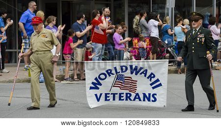 Bangor, Maine/USA-May 25: WWII Veterans march holding a banner in the May 25, 2015 Memorial Day Parade in Bangor, Maine.