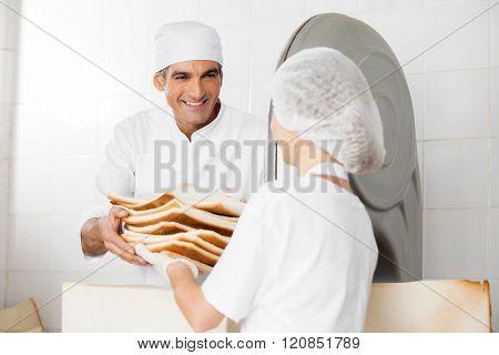 Happy Baker Receiving Bread Waste From Coworker