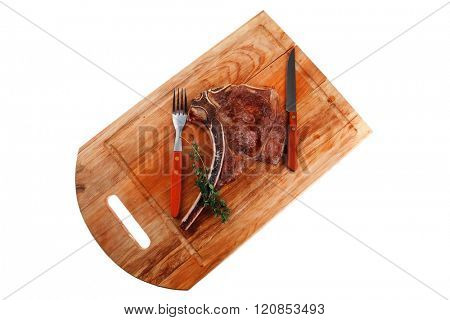 meat food : roast rib on wooden plate with thyme isolated over white background