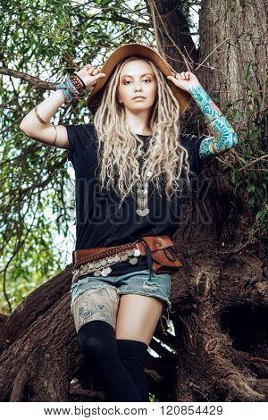 Portrait of a beautiful boho style girl in the wild wood. Boho, hippie fashion shot.