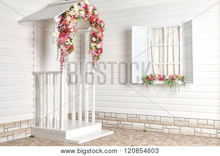 White house with flowers and white porch. Provence.