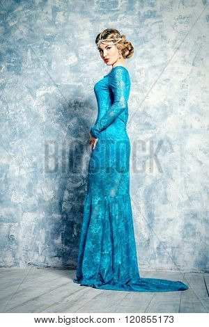 Full length portrait of a beautiful lady in long evening dress. Jewellery. Luxurious lifestyle. Studio shot.