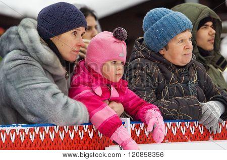 Mom, Grandma And Doughter On Tribune