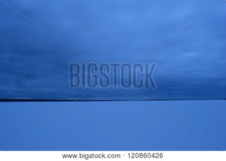 The Sky Over The Lake In Winter In Dense Clouds Late In The Evening Before Snow Precipitation