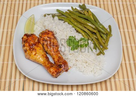 Indonesian Chicken Drumsticks With Rice, Lime And Sajoer Beans