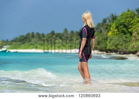 Woman Holding Mask And Flippers For Swimming On The Background The Beach