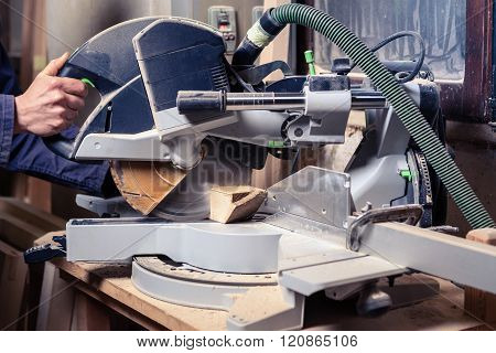 Carpenter's Hands Using Circular Saw