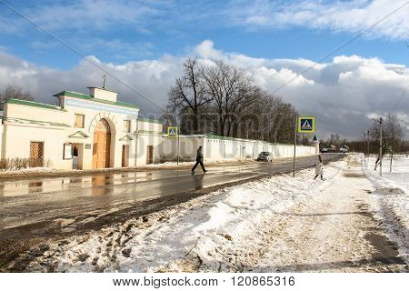 Staraya Ladoga, Russia - 23 February, People crossing the road near the monastery, 23 February 2016. Tourist places in the great ancient route from the Vikings to the Greeks. Staroladozhsky Holy Assumption nunnery. Gold ring of Russia.