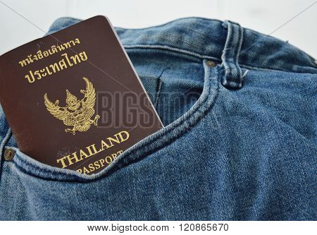 Thai passport in blue jean pocket