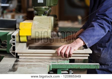 Carpenter's Hands Cutting Wooden Window Frame